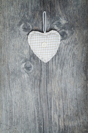 Christams heart on old wooden background photo
