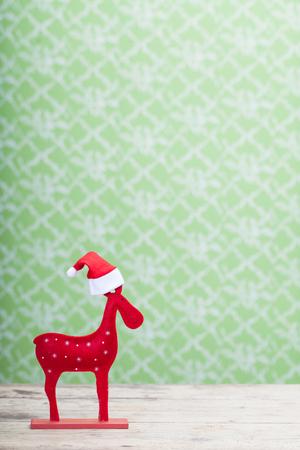 reno de navidad: Reno de la Navidad con el sombrero de santa