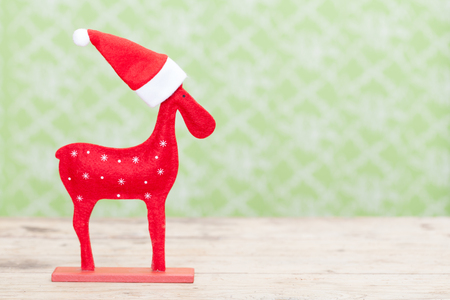Christmas Reindeer with santa hat photo