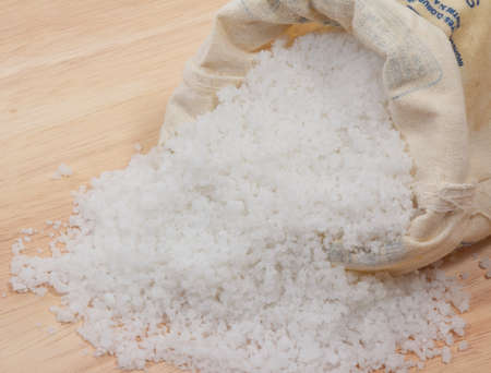 unrefined: sea salt in a sack on wood table