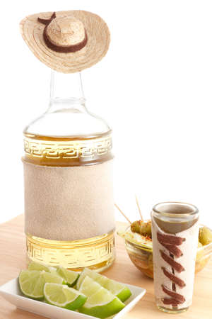 tequila bottle with sombrero and rough leather blank label Stok Fotoğraf