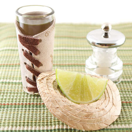 tequila shot with lime on sombrero and salt photo