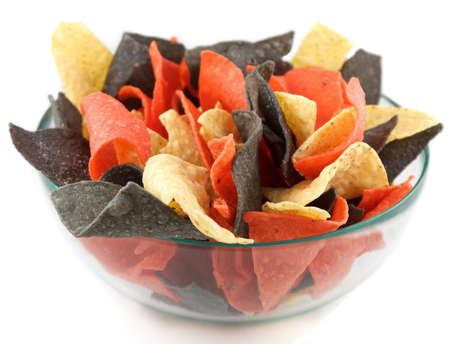 Glass bowl with mexican style corn chips in white, red and purple color on white background