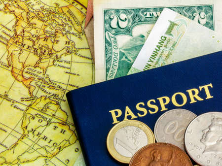 foreign: Blue passport with world currency and map of america Stock Photo