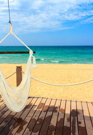 A beautiful view of the mexican coastline and the Sea of Cortez with an inviting hammock, portrait Stok Fotoğraf