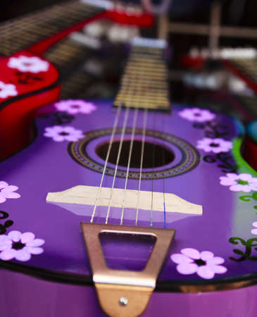 A colorful handcrafted Mexican acoustic guitar photo
