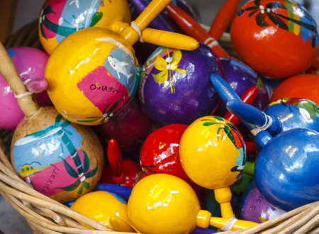 A basket full with colorful hand painted Maracas (rattlers) from Mexico Stock fotó