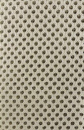 octogonal: Un patr�n de tejido con orificios octogonales Foto de archivo