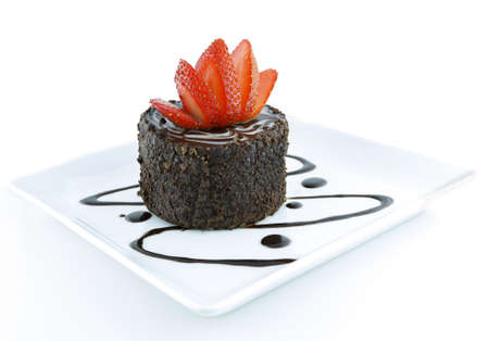 A delicious and tempting Chocolate pastry decorated with a flower cut Strawberry