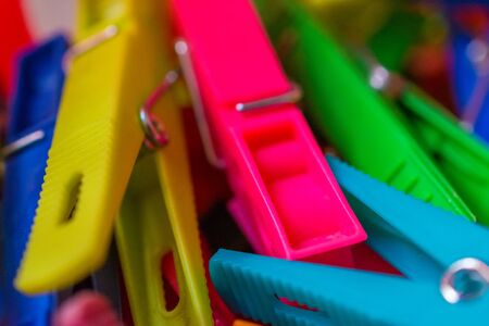 macro detail of a lot of colored clothespins