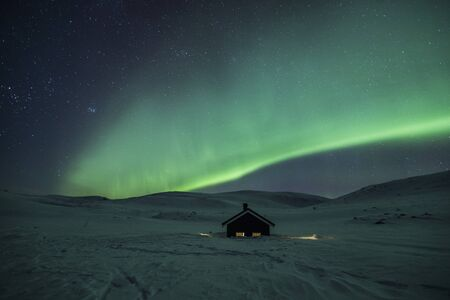 Northern lights in Reinheim Cabin, Dovrefjell National Park, Norway