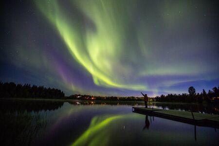 Northern lights and man in Kiruna, Lapland, Sweden