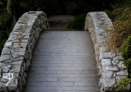 Old style bridge on a tranquil public park
