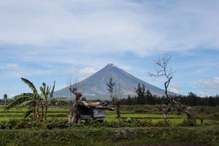 Far view from a perfect volcano behind a small local hut