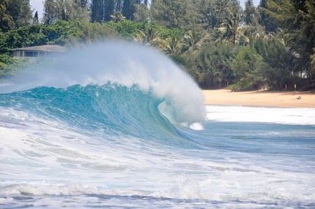 Waves breaking on the shore of Maui photo