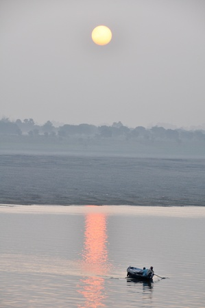 Sunrise on the Ganges river, Varanasi (India) photo