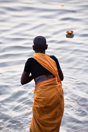 Sadhu praying at the ghats in Varanasi  India  photo