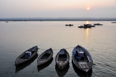 holiest: A sunrise looking over the holiest of rivers in India  The Ganges  Stock Photo