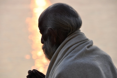 Sadhu praying at the ghats in Varanasi  India  Stock Photo - 14521296