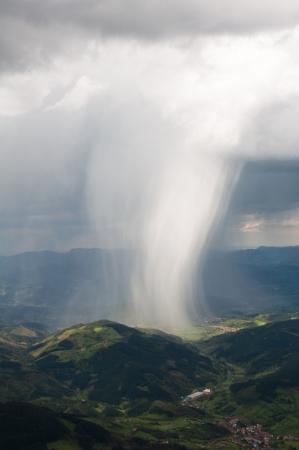 basque country: Rain Storm over Aizkorri range , Basque Country  Spain  Stock Photo