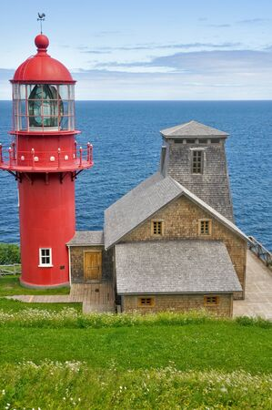 Pointe a la Renommee lighthouse, Quebec  Canada  photo