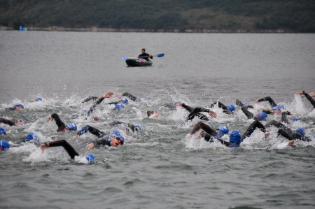 VITORIA-GASTEIZ, SPAIN - JULY 29 2012   Athletes competing in the swimming section in the Long Distance Triathlon World Championships, July 29, 2012 in Vitoria Gasteiz, Basque Country, Spain Stock Photo - 14628578