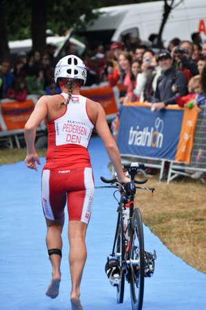 gasteiz: Camilla Pedersen  sub-champion  on transition zone in the Long Distance Triathlon World Championships, July 29, 2012 in Vitoria Gasteiz, Basque Country, Spain Editorial