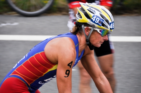 Female athlete competing in the cycling section of the Long Distance Triathlon World Championships, July 29, 2012 in Vitoria Gasteiz, Basque Country, Spain