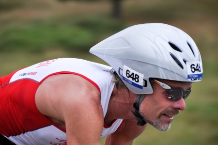 gasteiz: Male athlete competing in the cycling section of the Long Distance Triathlon World Championships, July 29, 2012 in Vitoria Gasteiz, Basque Country, Spain