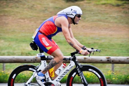 gasteiz: VITORIA-GASTEIZ, SPAIN - JULY 29 2012  Male athlete competing in the cycling section of the Long Distance Triathlon World Championships, July 29, 2012 in Vitoria Gasteiz, Basque Country, Spain