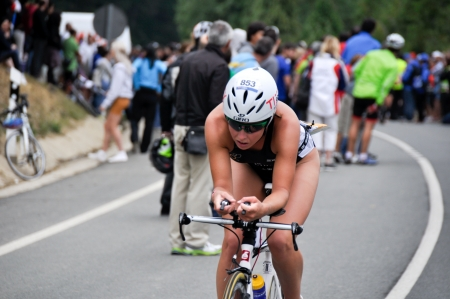 gasteiz: VITORIA-GASTEIZ, SPAIN - JULY 29 2012  Female athlete competing in the cycling section of the Long Distance Triathlon World Championships, July 29, 2012 in Vitoria Gasteiz, Basque Country, Spain