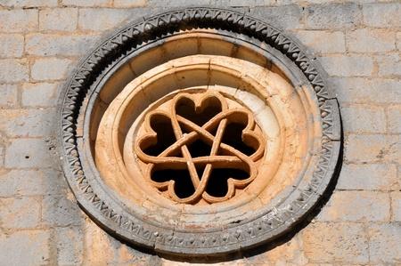 pentacle: The pentalpha of a rose window, St Bartholomew hermitage, Spain