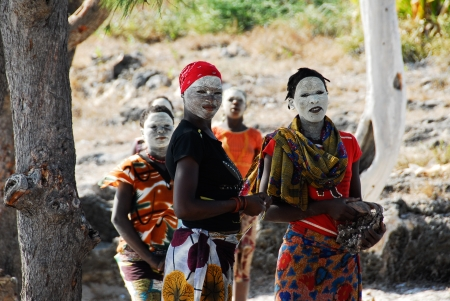 Makua women with white face mask, August 27, 2009 in Pangane, Mozambique Stock Photo - 17092136