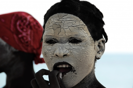 Makua woman with white face mask, August 27, 2009 in Pangane, Mozambique Stock Photo - 17092135