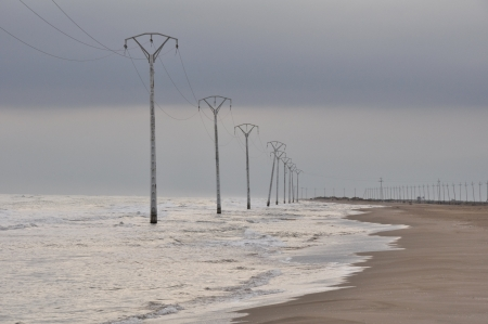 isthmus: Electric powerline at Trabucador isthmus, Spain Stock Photo