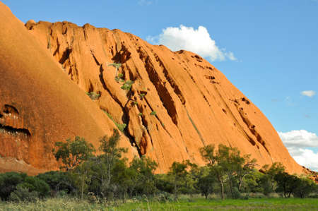 large formation: Uluru (Ayers Rock) is a large sandstone rock formation in the Northern Territory, Australia. This rock is sacred to the Aboriginal people.