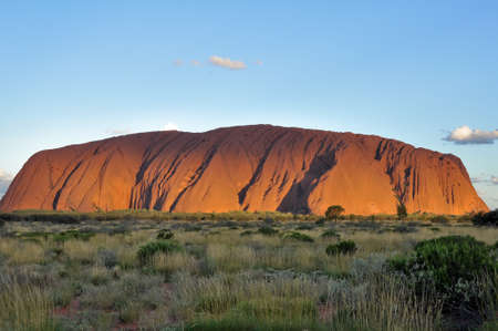 springs: Sunset at Uluru (Ayers Rock), a large sandstone rock formation in the Northern Territory, Australia. This rock is sacred to the Aboriginal people.