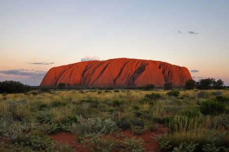 ayers: Sunset at Uluru (Ayers Rock), a large sandstone rock formation in the Northern Territory, Australia. This rock is sacred to the Aboriginal people.