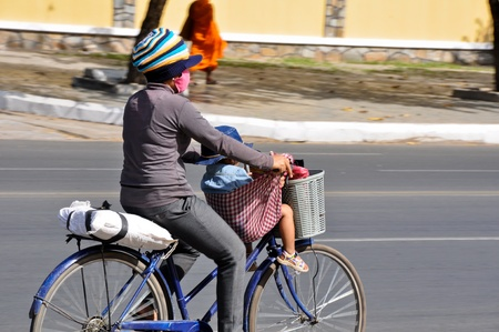 Mother and child riding bike together, Phnom Penh, Cambodia Stock Photo - 20691795