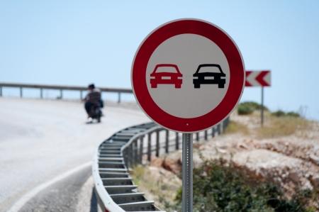 overtaking: Prohibited overtaking signal on the road Stock Photo