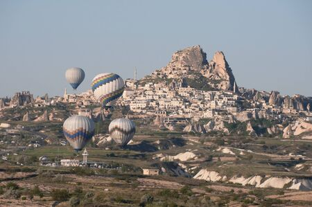 Hot air balloon fly over Cappadocia, the best attraction for tourists, on April 30, 2013 in Cappadocia, Turkey