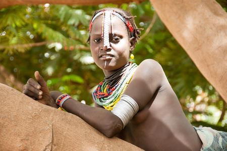 ethiopian ethnicity: Unidentified girl wears traditional clothes on August 11, 2007, near  Lake Turkana, in Omo Valley, Ethiopia   Editorial