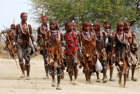 Unidentified women dance in the Bull Jumping Rituals on August 10, 2007 in Omo Valley, Ethiopia   Editorial