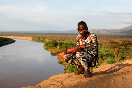 Unidentified Karo Man with Omo River in the background on August 11, 2007 in Omo Valley, Ethiopia