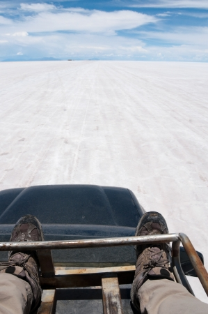 Traveling on a car top, Salar de Uyuni, Bolivia Stock Photo - 25069011