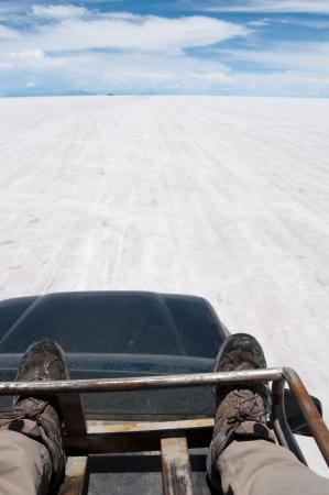 Traveling on a car top, Salar de Uyuni, Bolivia Stock Photo - 25069011