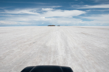 Traveling on a car top, Salar de Uyuni, Bolivia photo