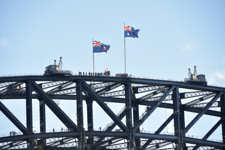 tour guide: A group of people at the top of the Sydney harbour bridge