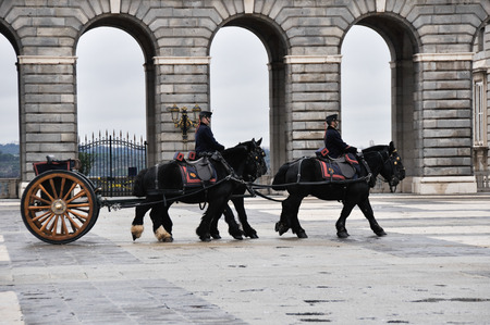 reenactment re enactment: Royal Guards participate in the Changing of the Guard at Royal Palace on february 12, 2014 in Madrid, Spain