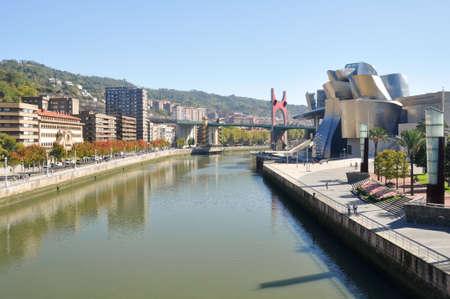 Nervion river, La Salve bridge and Guggenheim Museum in Bilbao, Spain Modern city near Nervion river  photo